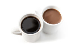 Two cups full of coffee stand on table with shadow Royalty Free Stock Photos