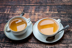 Two cups full of tea on old wooden table Royalty Free Stock Images