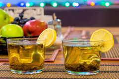 Two cups of green tea with lemon Stock Image