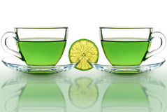 Two cups of green tea with lemon on a white background Stock Photo