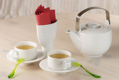 Two cups of green tea and teapot Stock Photo