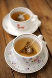 Two cups of green tea in triangle bagks Royalty Free Stock Image
