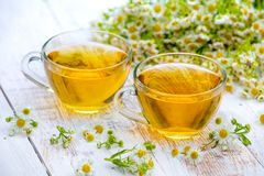 Two cups of herbal tea. On the grunge wooden table Royalty Free Stock Images