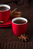 Two cups of hot chocolate. On brown knitted scarf Stock Photos