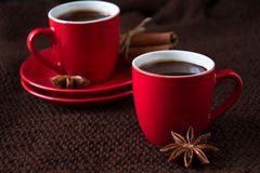 Two cups of hot chocolate. On brown knitted scarf Royalty Free Stock Photography