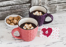Two cups of hot chocolate with marshmallows, cookies  and  Valentine's day postcard Royalty Free Stock Photo