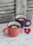 Two cups of hot chocolate with marshmallows and Valentine's day postcard Royalty Free Stock Photography