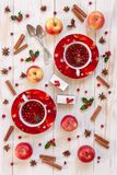 Two cups with hot Christmas fruit drink with spices, berries royalty free stock image