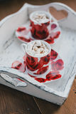 Two cups of hot cocoa with marshmallows and cinnamon on wooden background Stock Photography