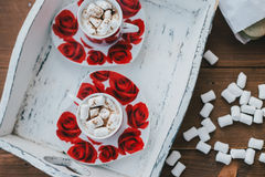Two cups of hot cocoa with marshmallows and cinnamon on wooden background Royalty Free Stock Photo