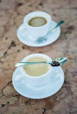 Two cups of hot coffee on a marble table Royalty Free Stock Photos