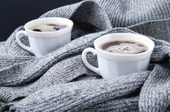 Two cups of hot coffee in the scarf close-up Royalty Free Stock Images