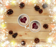Two cups of hot drink and festive tinsel. Concept. Christmas. Royalty Free Stock Images