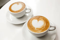 Two cups of hot latte stock photo
