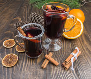 Two cups of hot mulled wine on a background of festive decorations. Christmas drink Royalty Free Stock Image