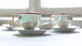 Two cups of hot tea and dessert on the table Royalty Free Stock Image