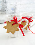 Two cups of hot tea and gingerbread Stock Images