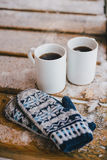Two cups of hot tea on the wooden table in a cold snowy weather Stock Photo