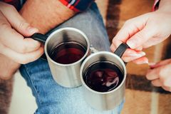 Two cups on the jeans knee in hands on picnic stock images