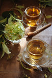 Two cups of linden tea with linden flowers Stock Images