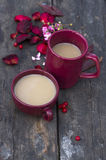 Two cups of masala tea on  wooden background. Two cups of masala tea on grunge wooden background Royalty Free Stock Photo