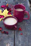 Two  cups of masala tea on wooden background Royalty Free Stock Image