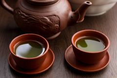 Two cups of matcha tea in a restaurant stock photo