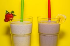 Two cups of milkshake stock images