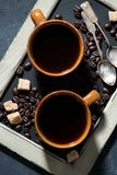 Two Cups Of Black Coffee And Sugar On The Blackboard, Top View Royalty Free Stock Photos