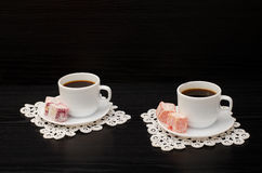 Two Cups Of Coffee On The Lace Napkins And Turkish Dessert On A Black Background Royalty Free Stock Photos
