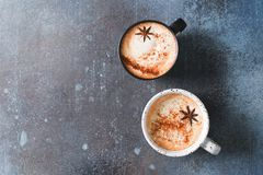 Free Two Cups Of Coffee With Crema, Cinnamon And Badian On Dark Background Royalty Free Stock Photography - 165452407