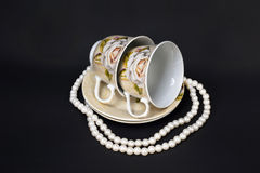 Two Cups and Pearls Royalty Free Stock Photos