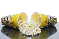 Two cups pf popcorn. Two cups of spilled popcorn Royalty Free Stock Photo