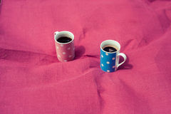 Two cups on a pink blanket Stock Photography