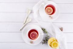 Two cups of red fruit and herbal tea with lemon slice. Top view royalty free stock photo