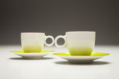 Two cups red and green. Isolated. Cup and saucers, nice couple Royalty Free Stock Image