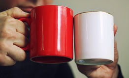 Two cups, red and white Royalty Free Stock Image