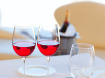 Two cups of red wine and bottle in ice bucket Stock Images