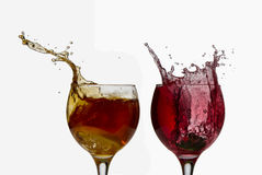 Two cups with refreshing drinks,splashing Royalty Free Stock Photography