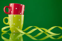 Two cups with ribbon Stock Photos