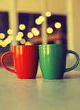 Two cups in  romantic light Royalty Free Stock Images