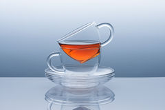 Two cups with saucers from the tea remains Royalty Free Stock Photos