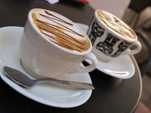 Two cups of serve coffee. Two cups of serve cappuccino Stock Photo