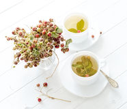 Two cups of strawberry tea royalty free stock photography