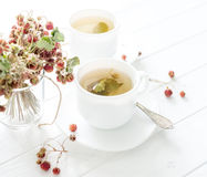 Two cups of strawberry tea stock photography