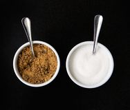 Two cups of sugar with spoons Stock Image