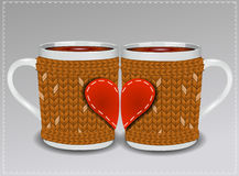 Two cups in a sweater decorated with hearts. Stock Images
