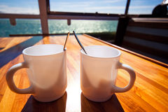 Two cups on table Royalty Free Stock Photo