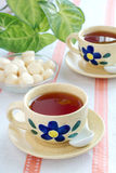 Two cups of tea. And candies Stock Photo