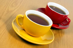 Two cups of tea. On wooden background Stock Image